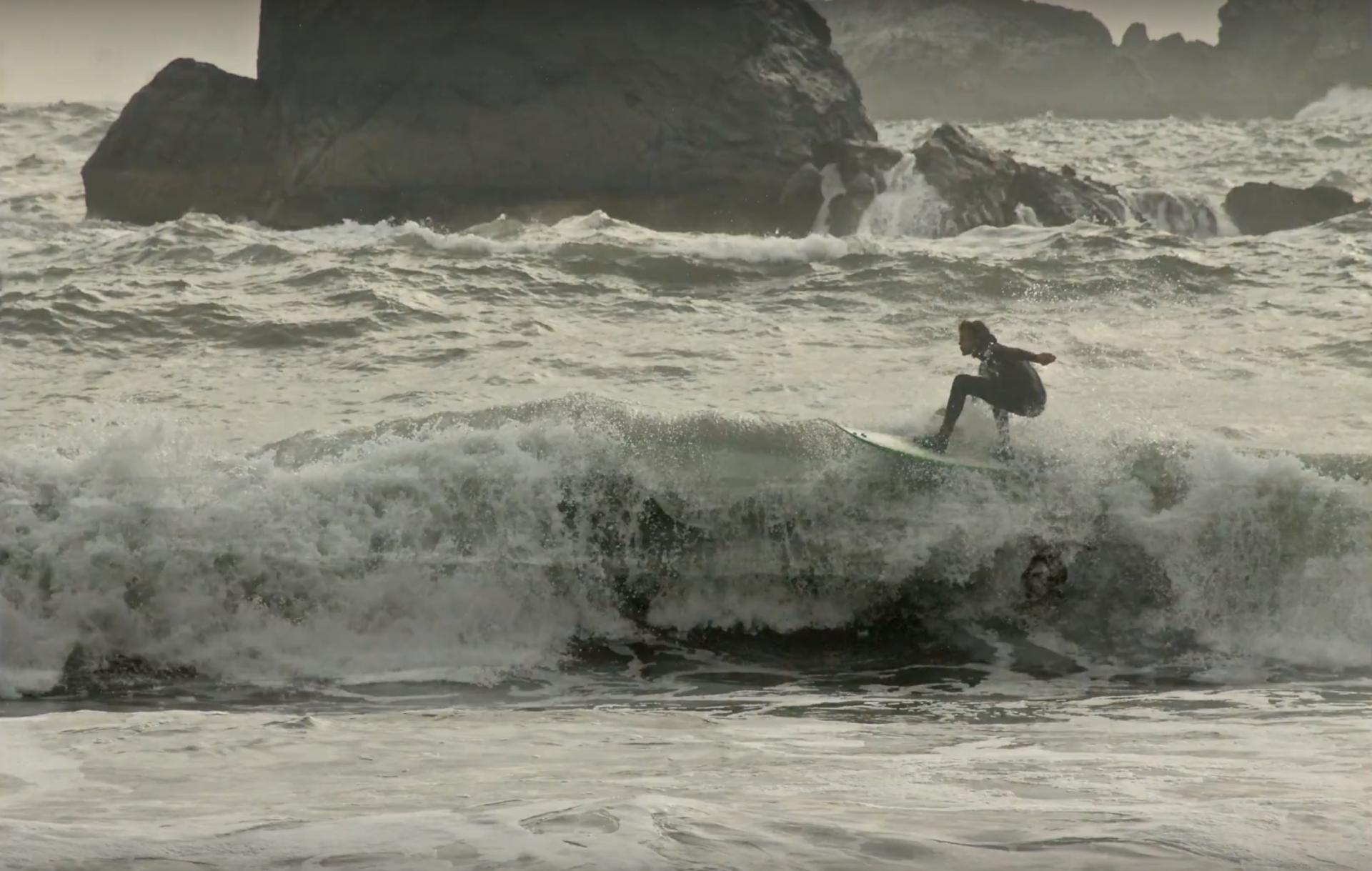 HSU psychology student William Doudna surfing in Humboldt. Photo by Michelle Meyers.