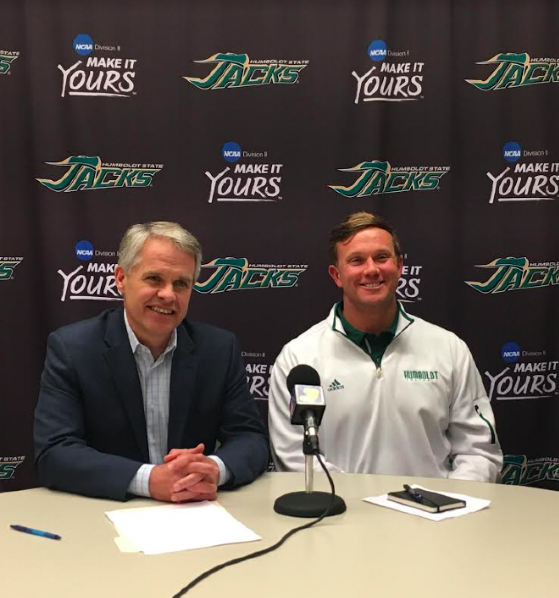 Athletic director Duncan Robins sits beside new interim head football coach Cory White during a press conference on Jan 29. Photo by Skye Hopkins.