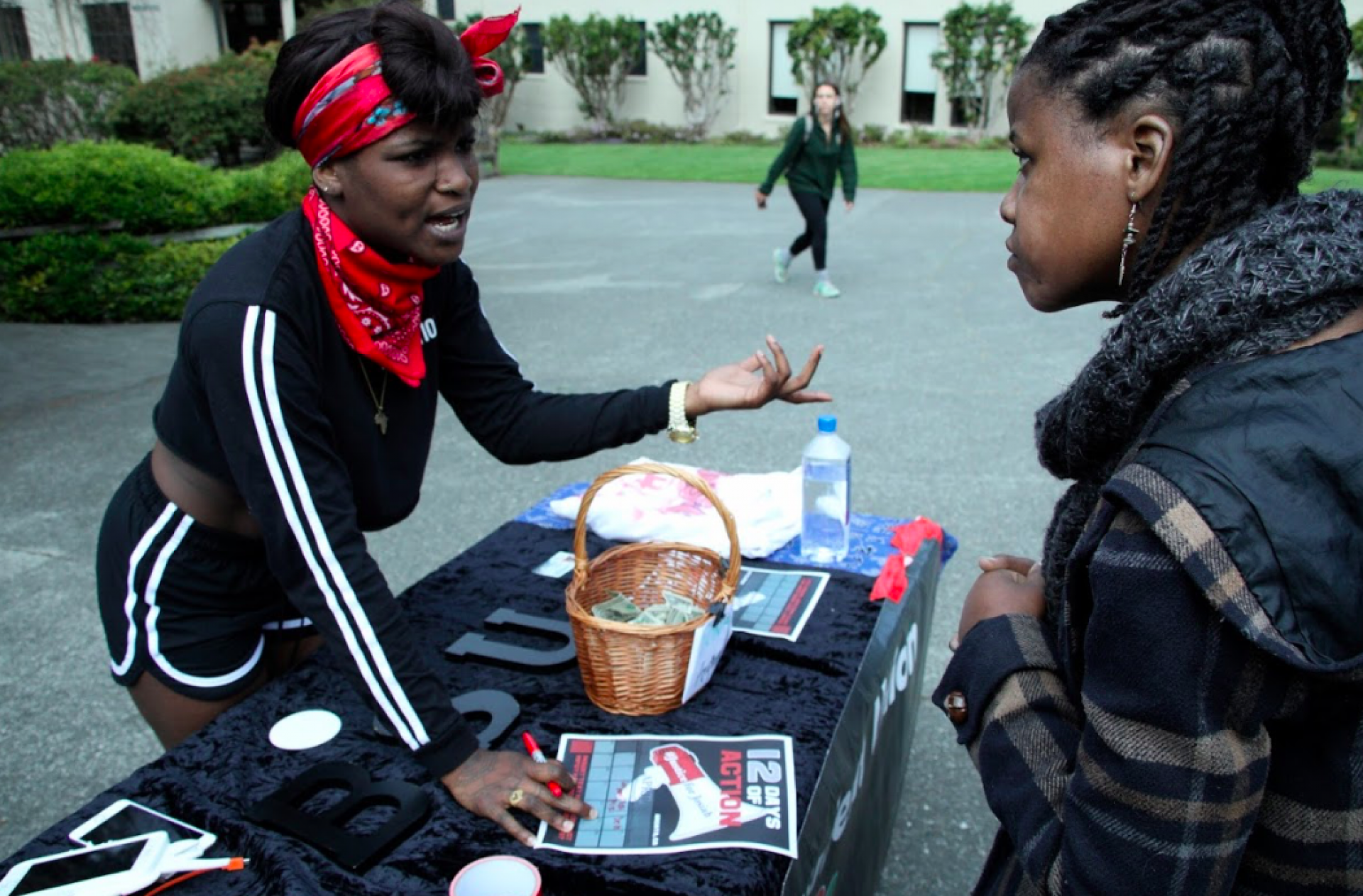 Barbara Singleton informs another student about the upcoming events taking place, leading up to the one-year anniversary of David Josiah Lawson's death that took place on April 15, 2017. Photo by Garrett Goodnight.