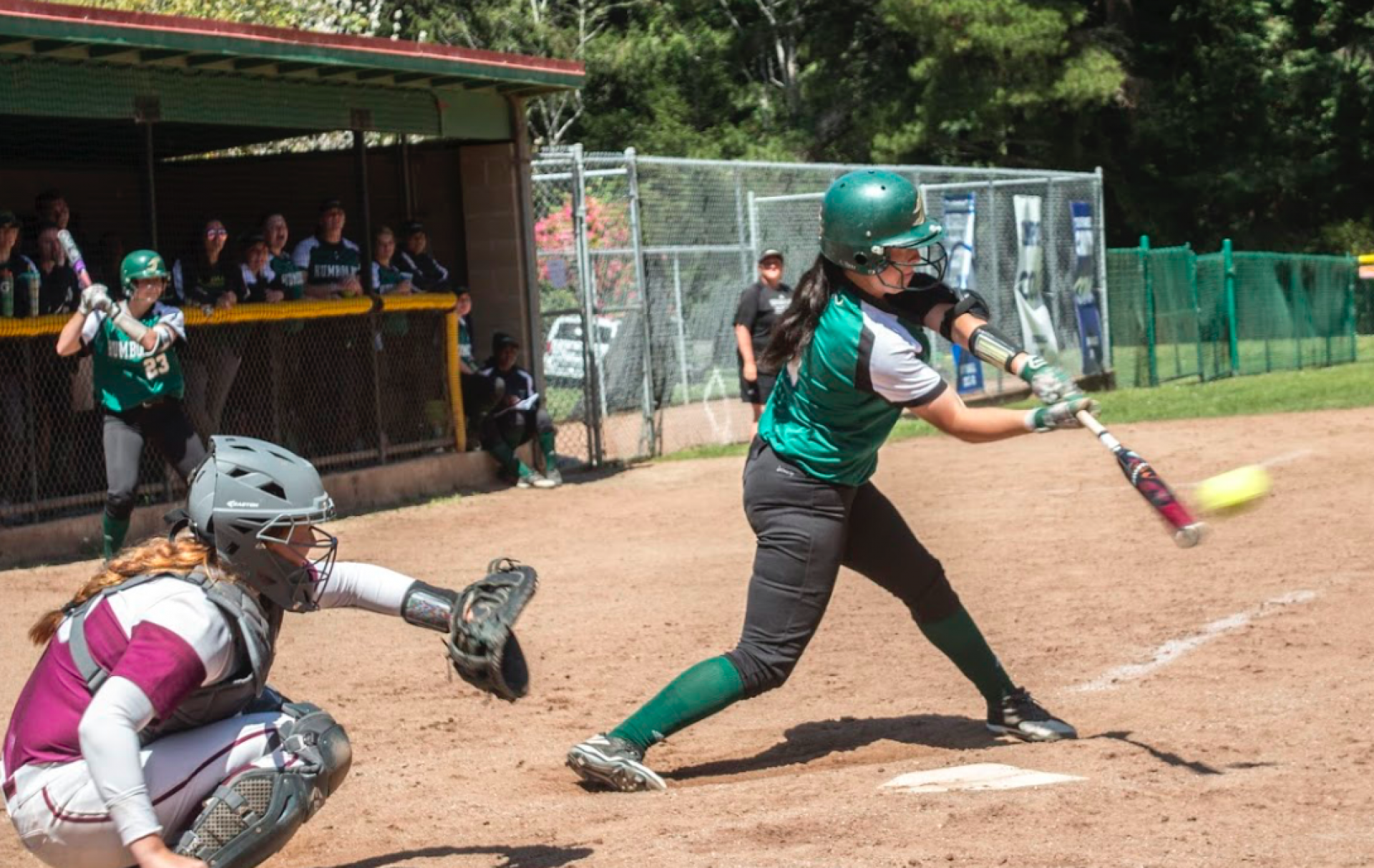 Humboldt State softball team played Chico State Wildcats on April 21. Game played at the Lumberjacks home field. HSU's Kelly Sonnemann up to bat. Chico catcher Claire Wayne arm stretched out. Final score 9-1. Chico won. Photo by Bailey Tennery.