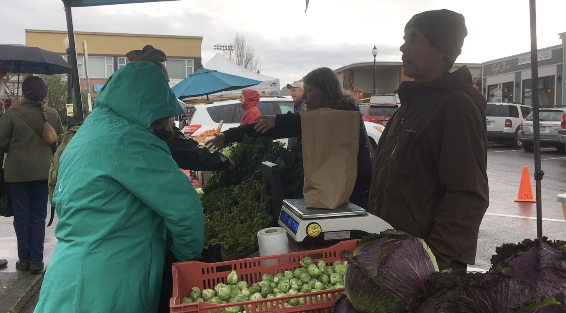 Fred and Amy Diekmeyer help customers at the Luna Farm stand at the Arcata Farmers Market on Saturday, Feb. 2.   Photo by Christina Samoy.