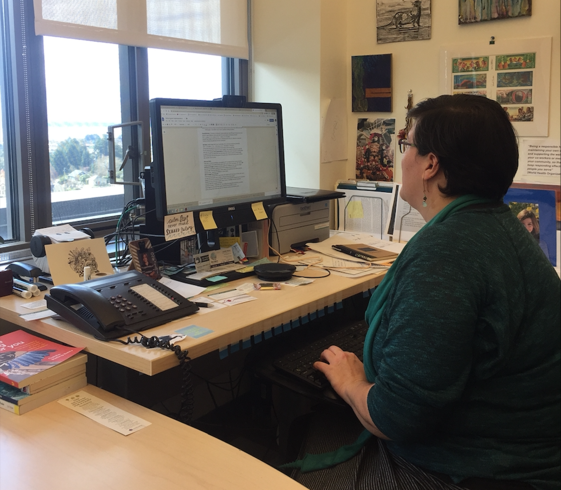 Director of Field Education at HSU's Department of Social Work Yvonne Doble sitting at her desk. A new U.S. Department of Education grant will help fund stipend social workers in local schools. | Photo by Jerame Saunders