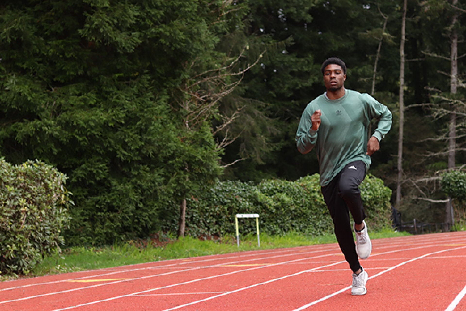 Humboldt State athlete Malachi Arthur takes a lap around the Redwood Bowl Field during track and field practice on Feb. 12. Photo by Diego Linares.