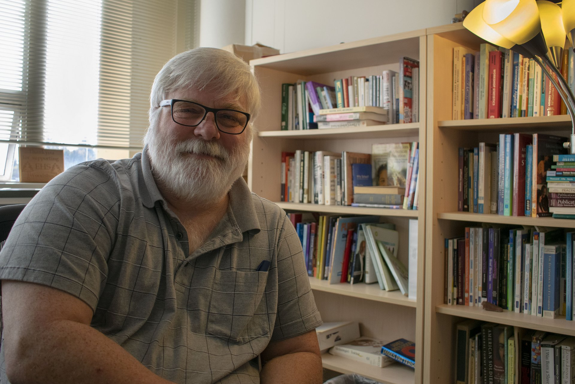 Humboldt State University Education Department Chair Eric Van Duzer sits in his office November 15, 2019. Retiring in May, Van Duzer has spent nearly 30 years at HSU and is calling for a returned focus on student success. | Photo by James Wilde