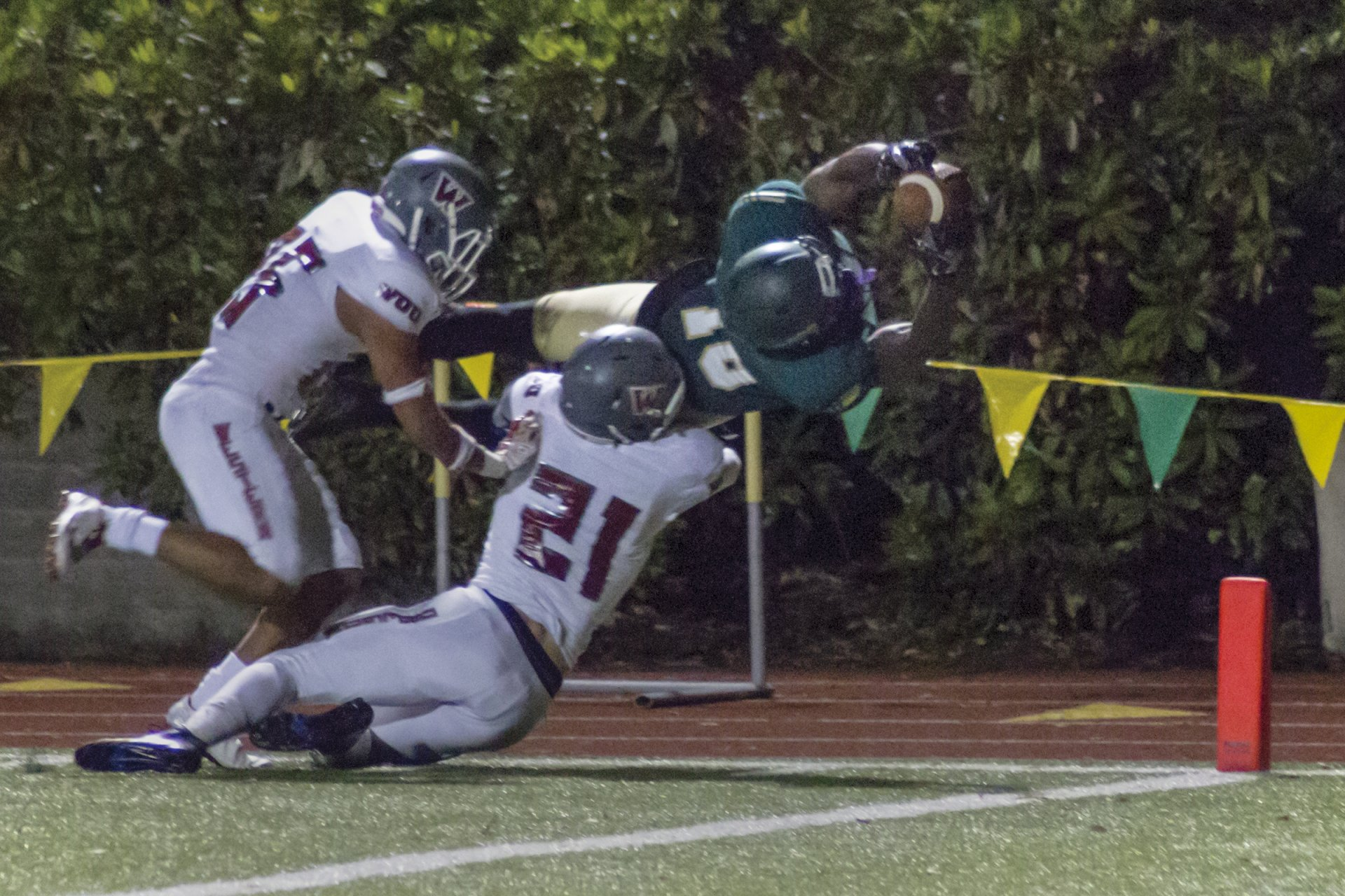 Jamere Austin scoring a touchdown by lunging into the end zone. | Ian Benjamin Finnegan Thompson
