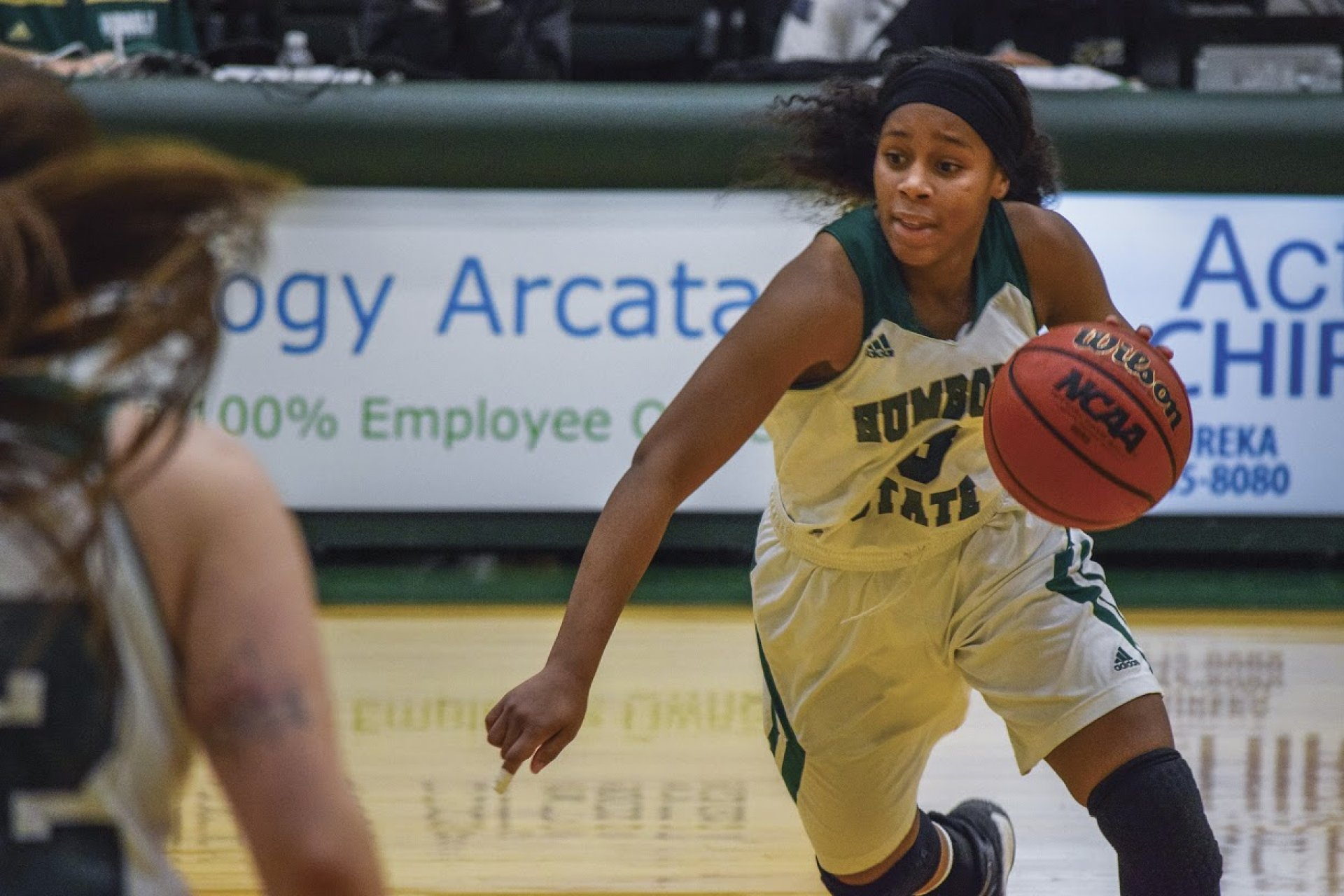 Jacks' guard Tyra Turner drives with the ball against a defender. | File photo by Alex Hasenstab