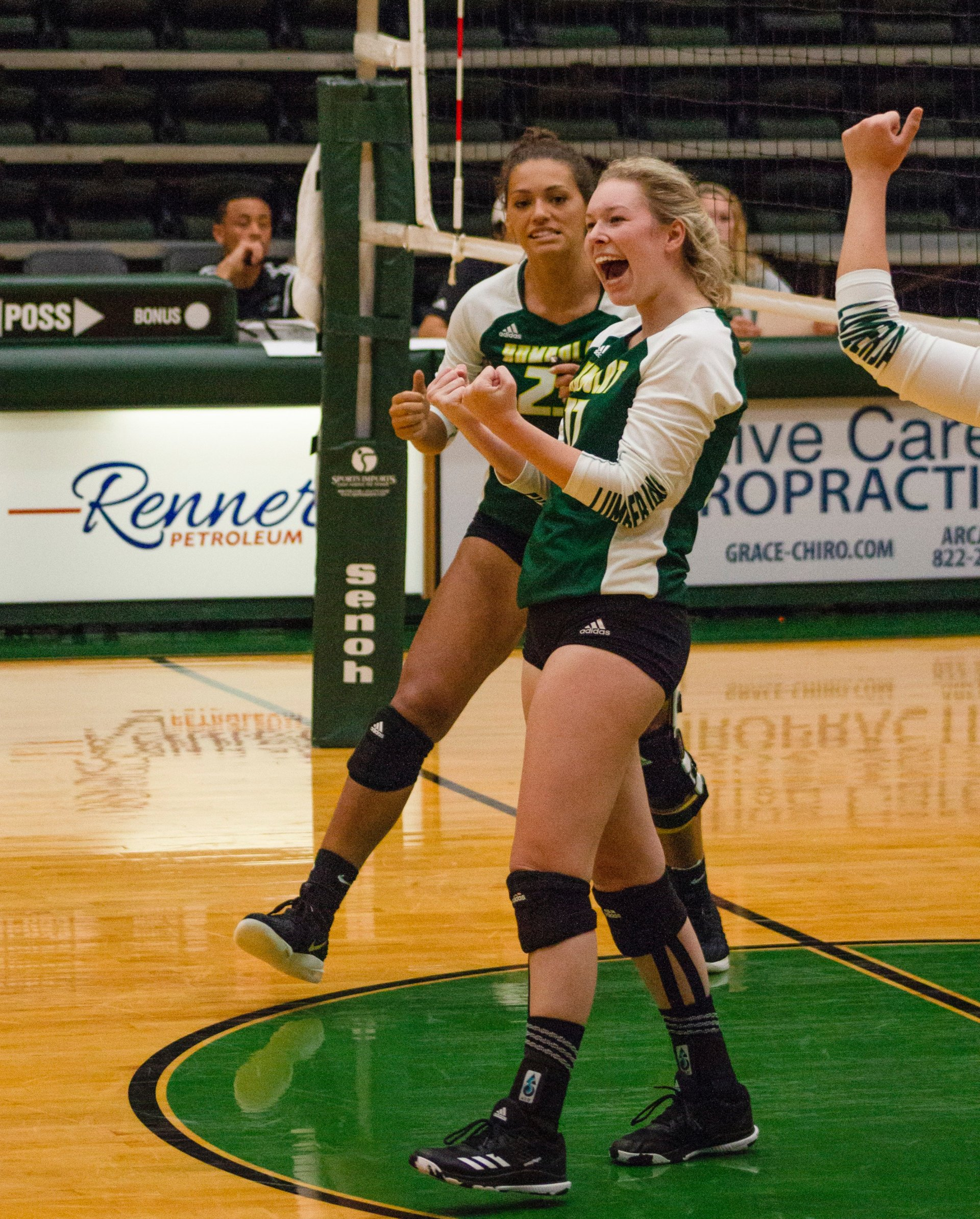 Hannah Cantrell (left) and Savannah Horton (right) celebrate a score against Stanislaus State Volleyball at the Lumberjack Arena on Saturday Sept. 29. | Photo by Lauren Shea