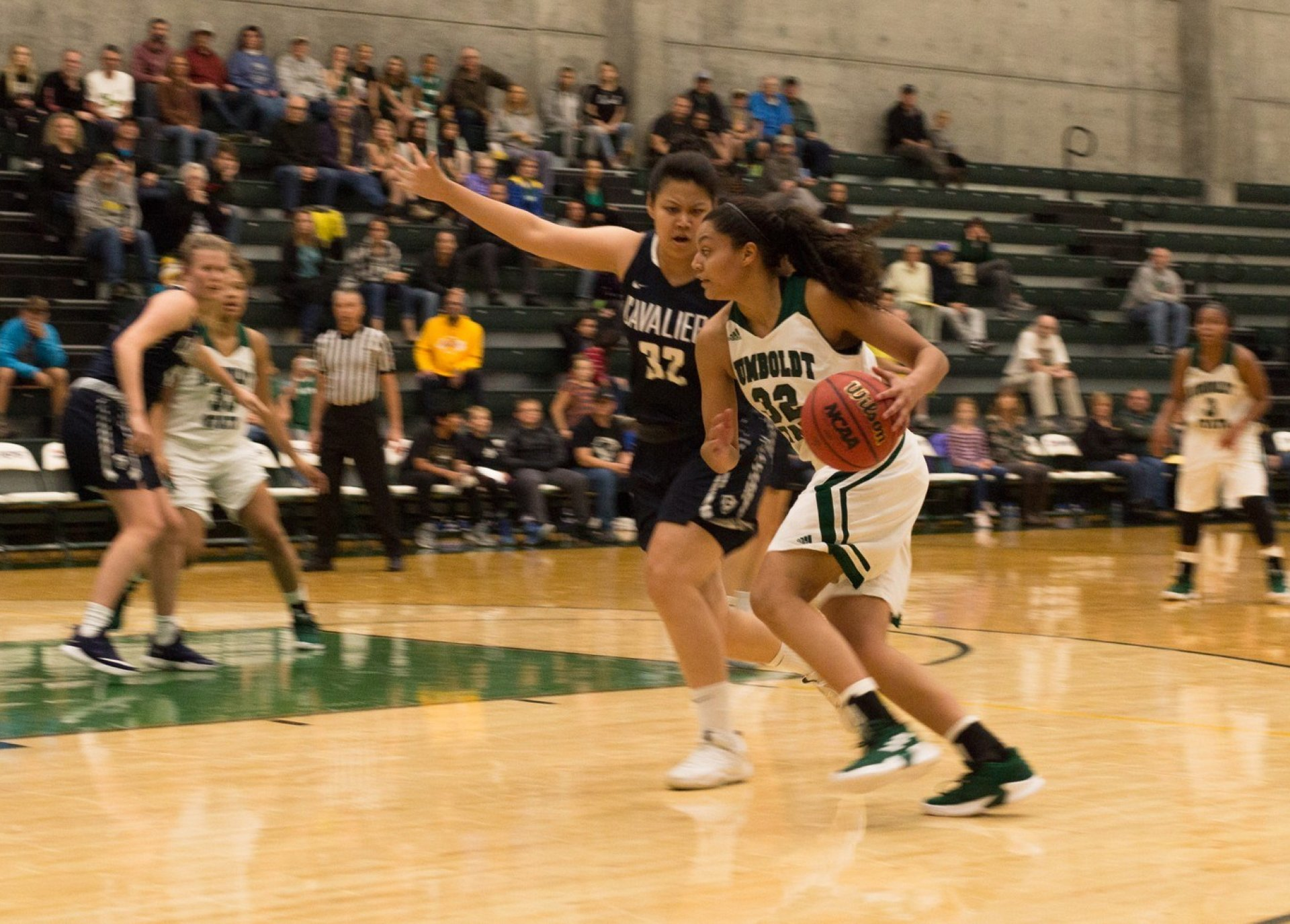 Lumberjacks forward Isa Conde (32) drives to her left against the Cavaliers defense. The Jacks fell to the Cavs in the game's last seconds 72-71 at Lumberjack arena on Nov. 20. | Photo by Lauren Shea