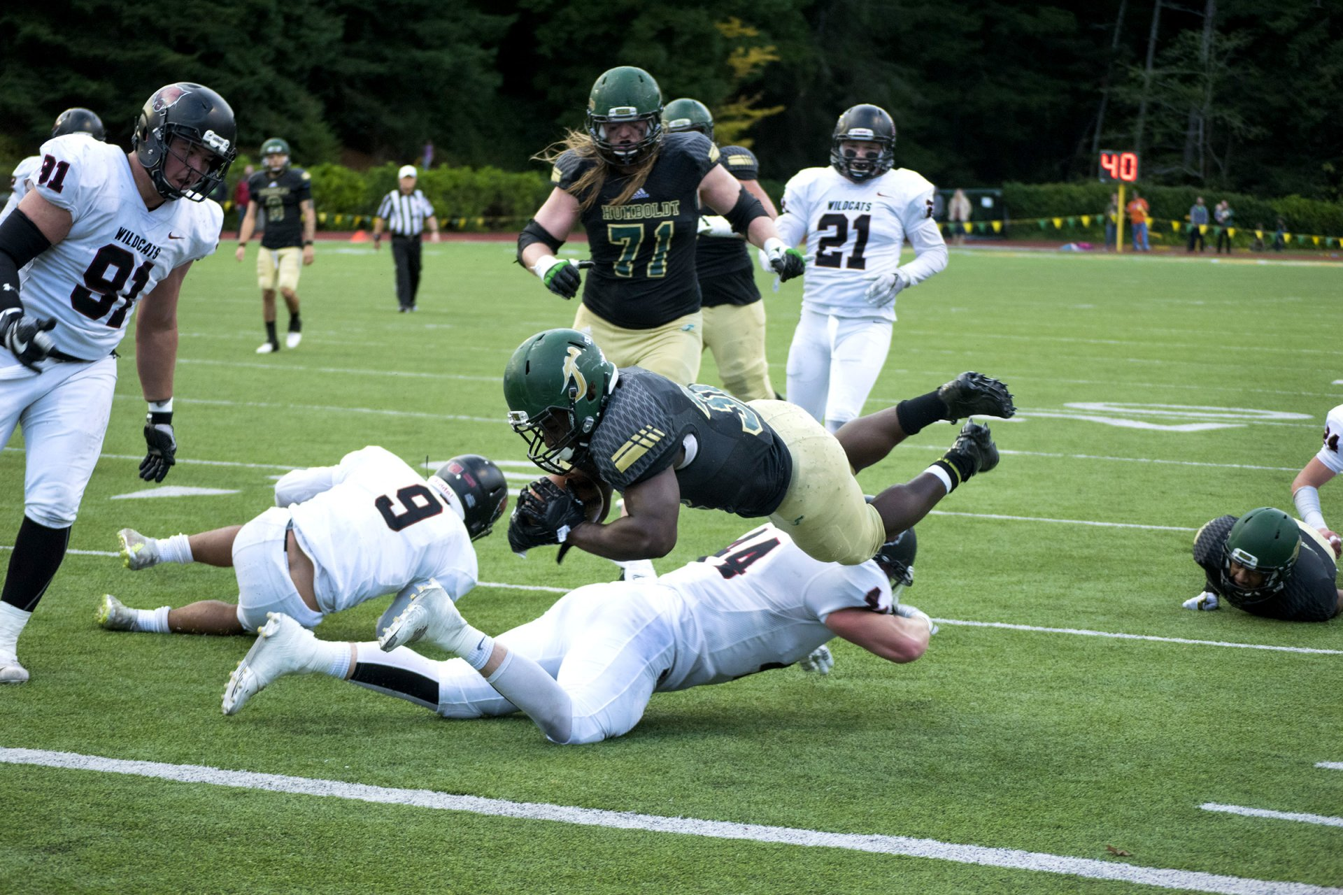 Humboldt State's Alex Cappa (71) blocks for Ja'Quan Gardner (32) as he scores one of the final touchdowns during the 4th quarter of Central Washington University's win of 42-28 at Redwood Bowl on Nov. 11th, 2017. | Photo by Deija Zavala