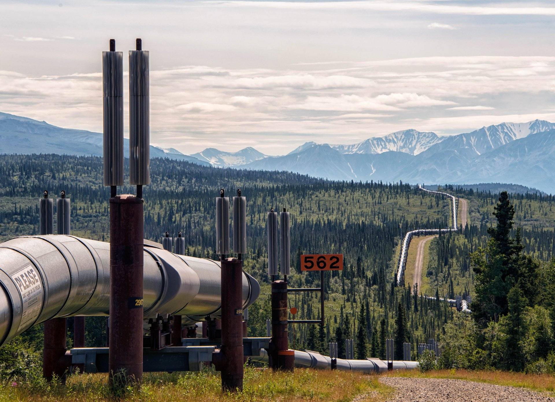 The trans-Alaskan pipeline transports thousands of gallons of oil across the Alaskan wilderness each day. | Photo by Luca Galuzzi
