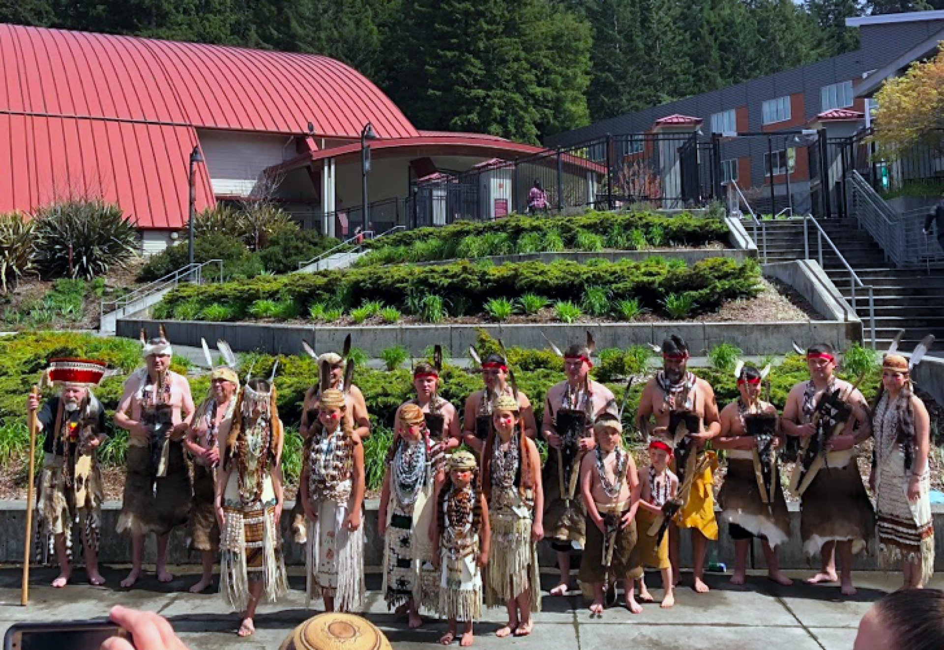 The Tolowa Nation Dancers pose near the Redwood Bowl at Humboldt State University on April 7. Photo by Garrett Goodnight.