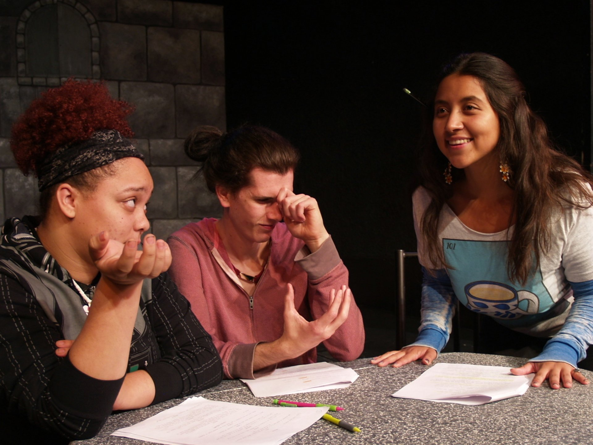 Actors Taiquira Williams, Maude Jaeb, and Drea Carillo acting out a scene from the play,