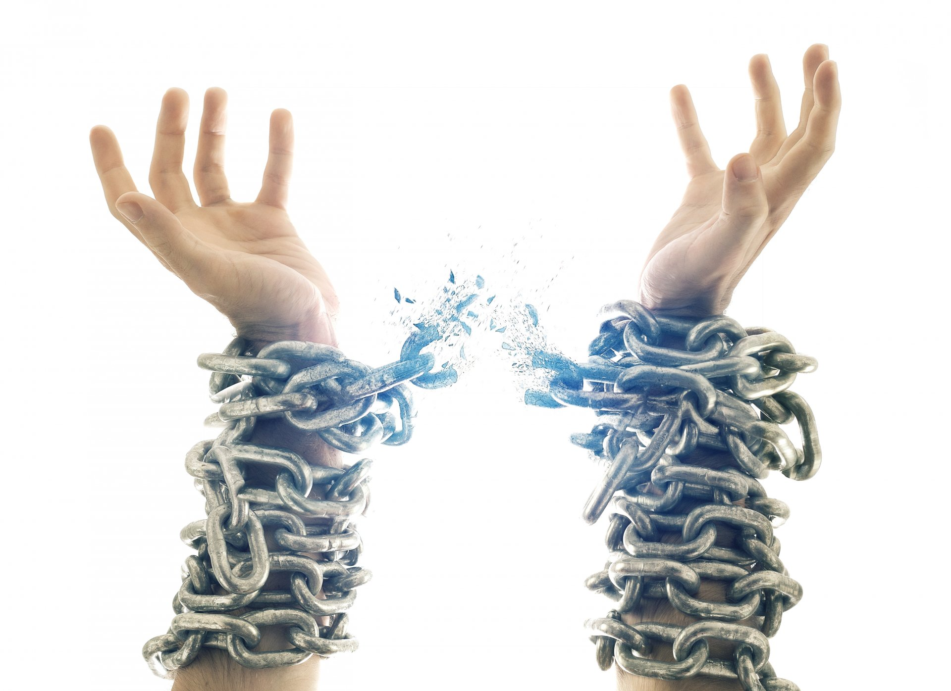 Two hands in chains that are breaking apart. (Courtesy of Adobe Stock by Kevin Carden)