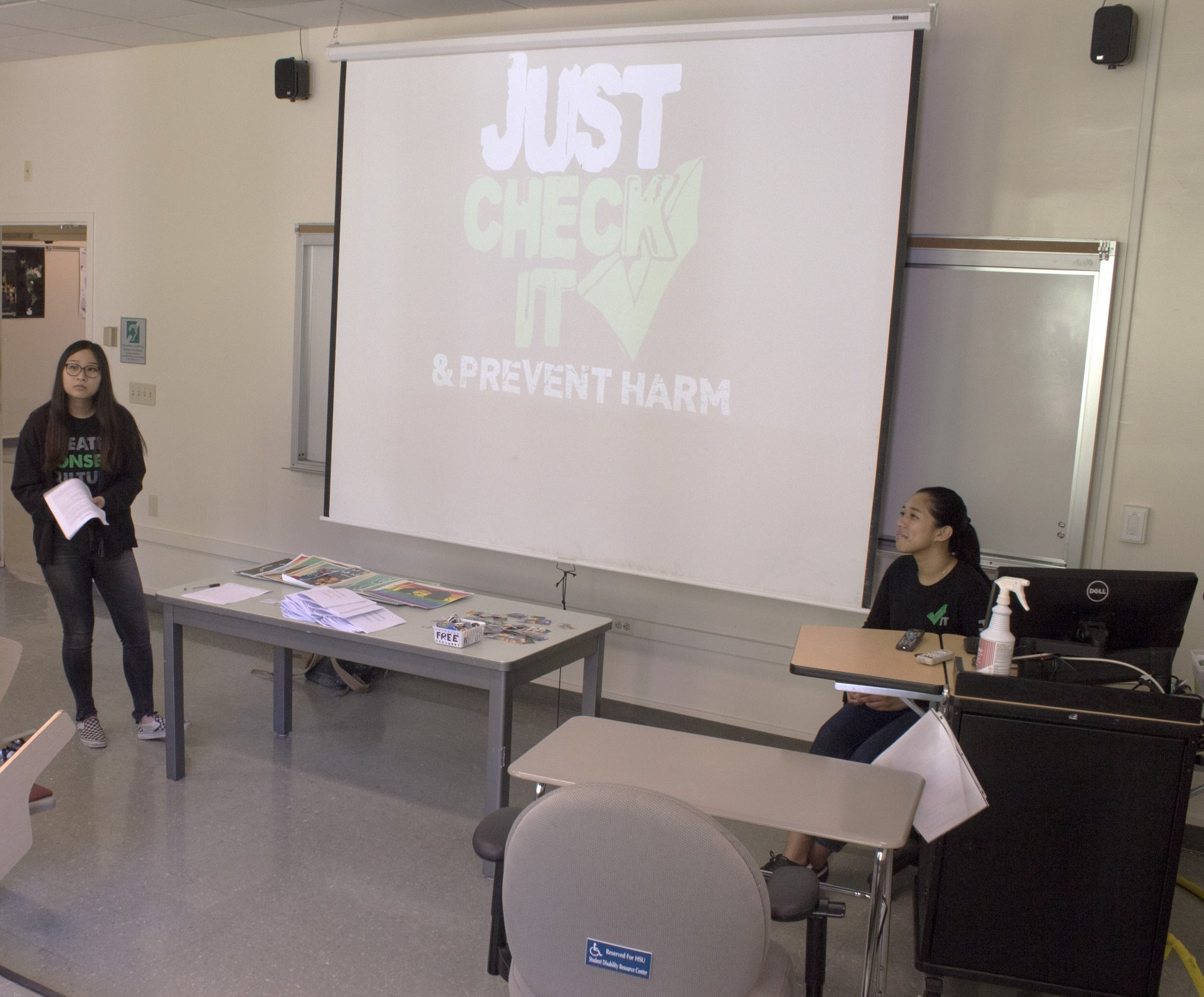 Skye Peredeo (right), 21,  and Adrienne Bahn, 19, hosts the Check It Bystander Intervention workshop on March 29. The workshop focused on teaching students the tools to intervene when they witness a moment of harm in the community. Photo by Abigail LeForge.