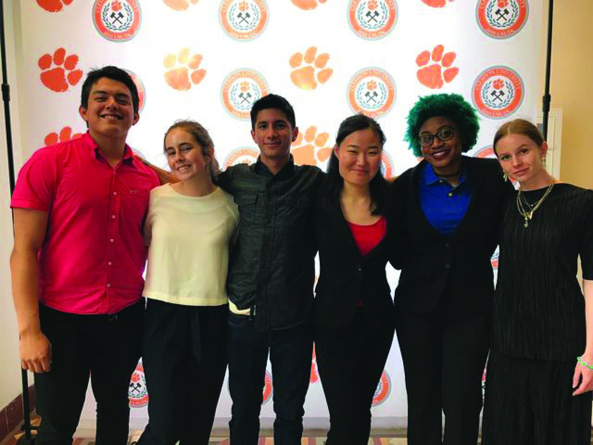 A few members of debate posing at Nationals. (From left to right) Fabian Cuevas, Sydney Verga, Devon Escoto, Hannah Koh, Arynn
