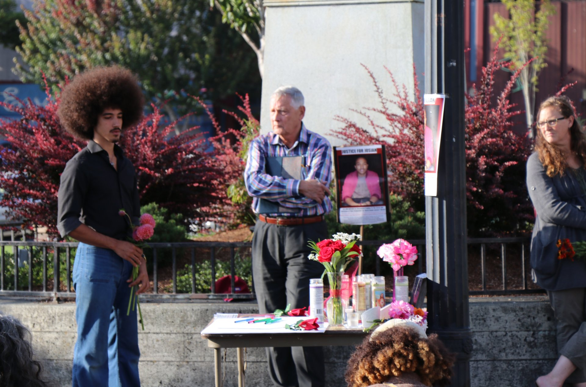 Leonard Perry prepares to lay flowers at a vigil for David Josiah Lawson, August 15, Arcata Plaza. | Photo by Curran Daly
