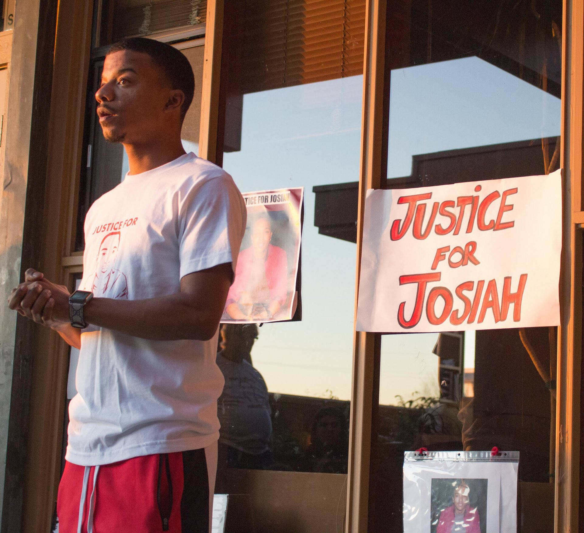 Karim Muhammed, a friend of David Josiah Lawson, discusses safety and racism in front of Arcata City Hall during Justice for Josiah's 18th vigil on Oct. 15, 2018. | Photo by Tony Wallin