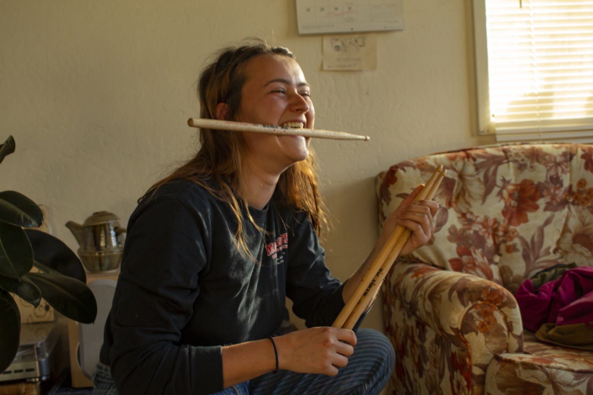 Kyra Teevan poses with her drumsticks on Nov. 2 in her home. | Photo by Deven Chavannes