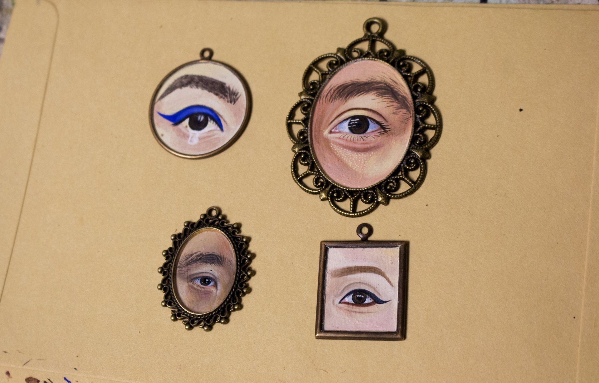 Pieces from Sarah Arias' series of gay lovers eyes | By Sarahi Apaez