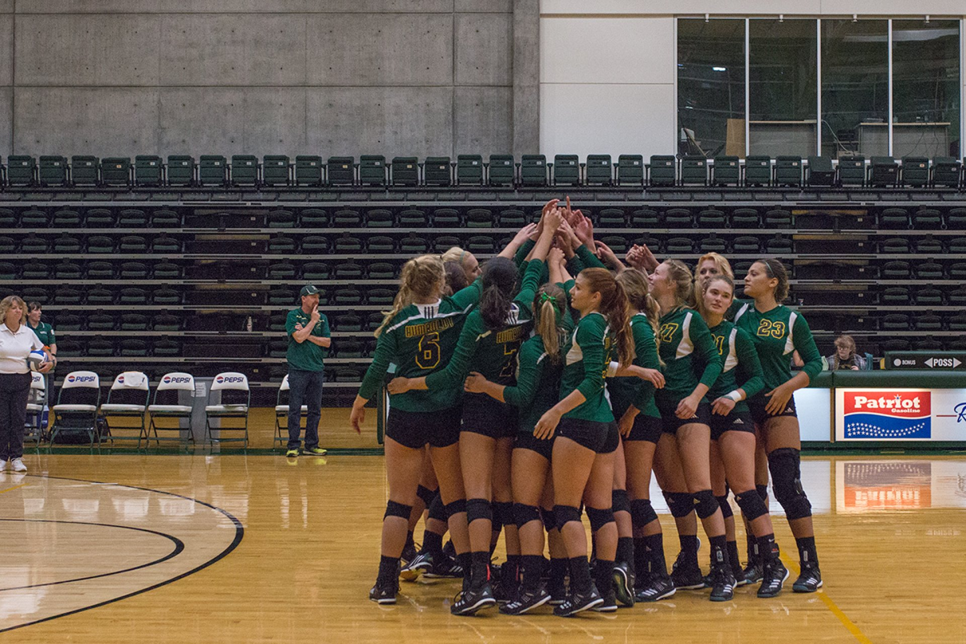 HSU Volleyball team huddles together in the Lumberjack Arena for the first game of the season against Academy of Art in the HSU Lumberjacks Arena on Thursday, August 31st. | Photo by Lauren Shea
