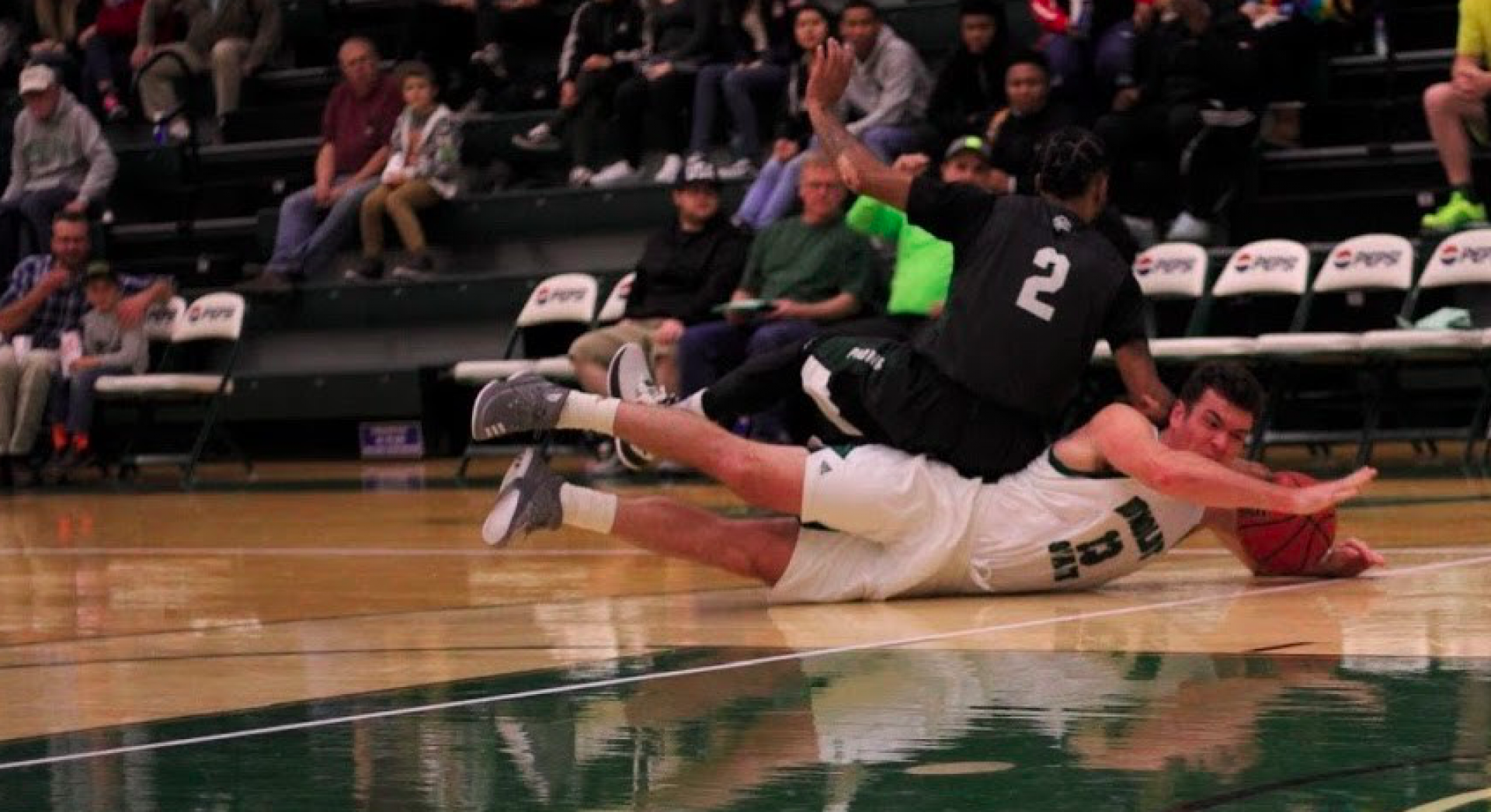 Jacks senior guard Will Taylor dives for the loose ball. The Jacks are currently on a three-game skid. Photo by Diego Linares.