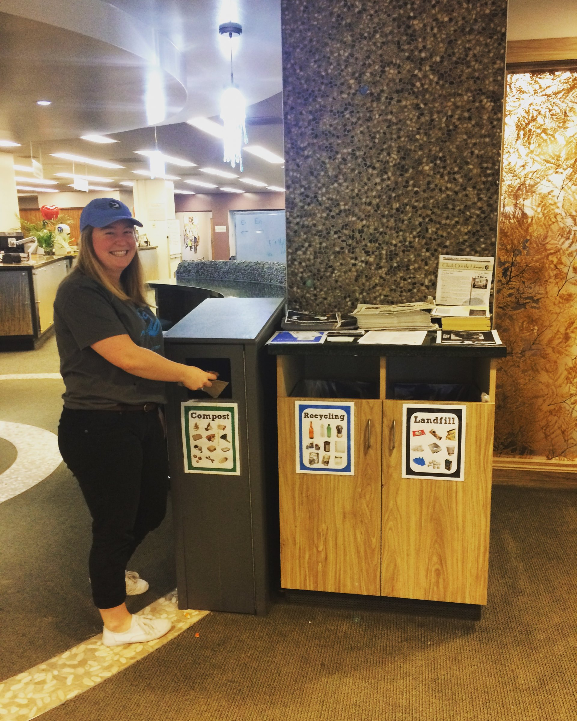 WRRAP intern Madison Peters with HSU Library recycling and waste bins. Photo by Molly Gilmore