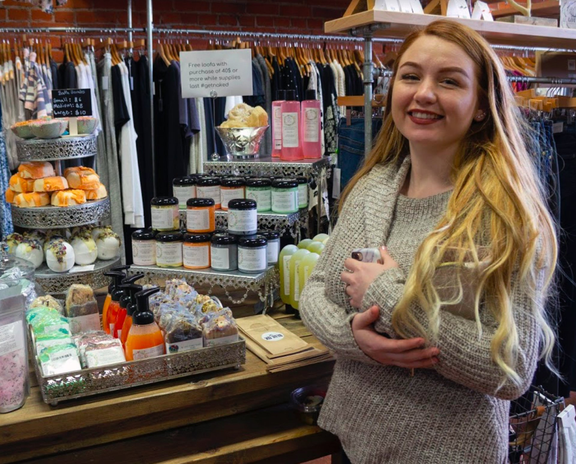 Violet Crane with her line Queen Bee Naturals after dropping them off in Blue Ox Boutique. Photo by Stella Stokes.
