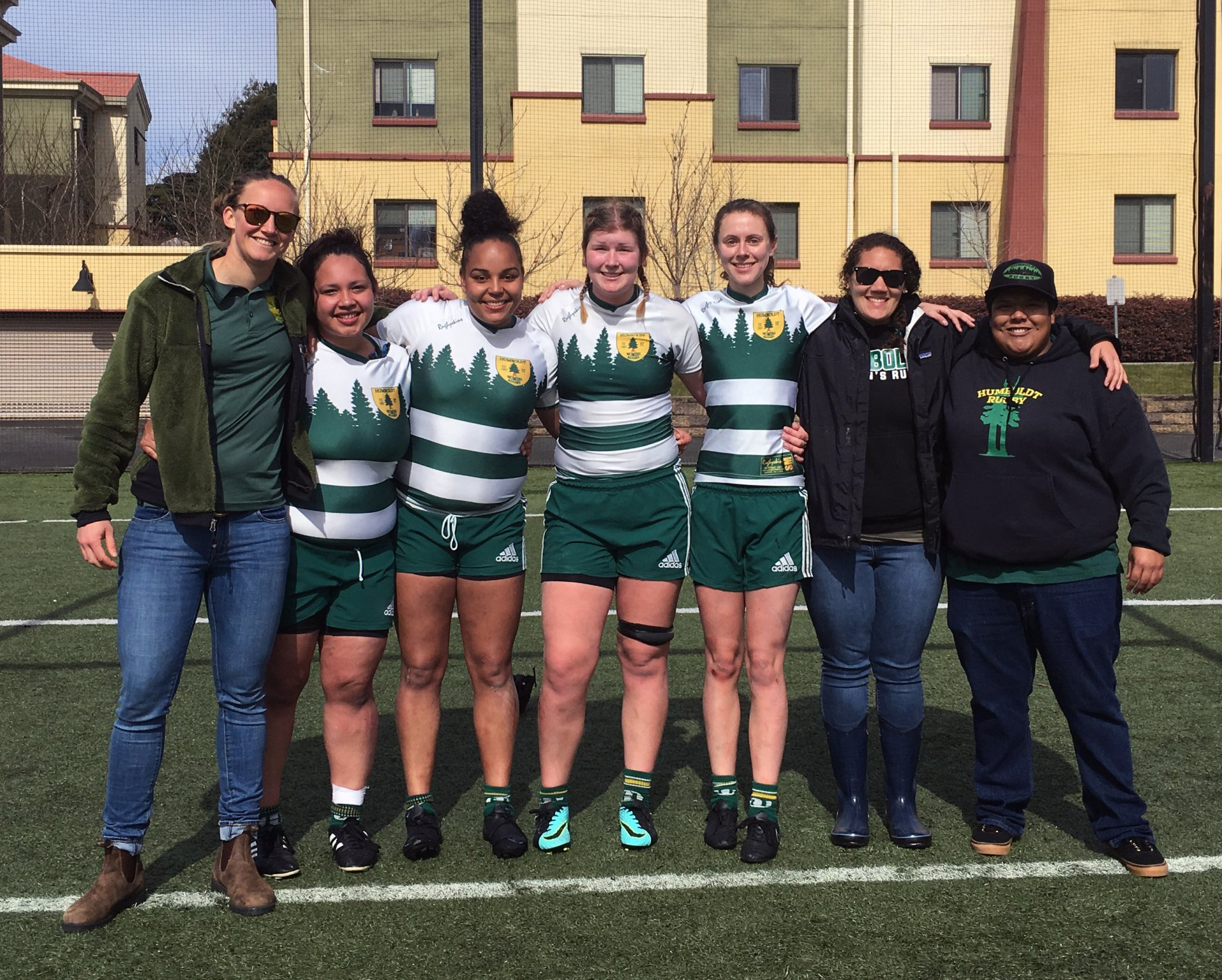 Seniors and coaches pose after their victory. Meredith Conrad-Forrest (left), Kayla Maulson, Lila Bell, Tori Laidlaw, Tristyn Berman, Krista Miller (forwards coach) and Loni Carrera (backs coach) at College Creek Field on March 3. Photo courtesy of Kiana Hargreaves.