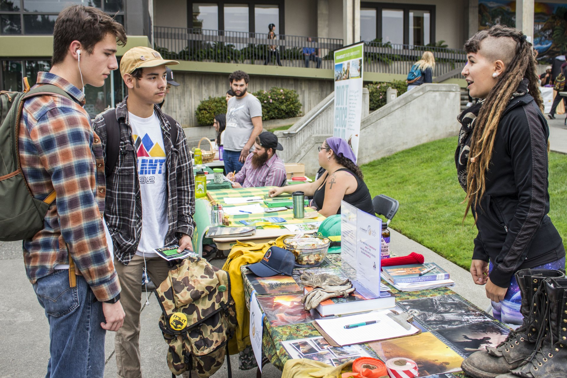 (left to right) Kyle Groben and Austin Prieto check out the SAFE ( Student Association for Fire Ecology) table with member and firefighter Tenaya Wood. | Photo by Ian Benjamin Finnegan Thompson