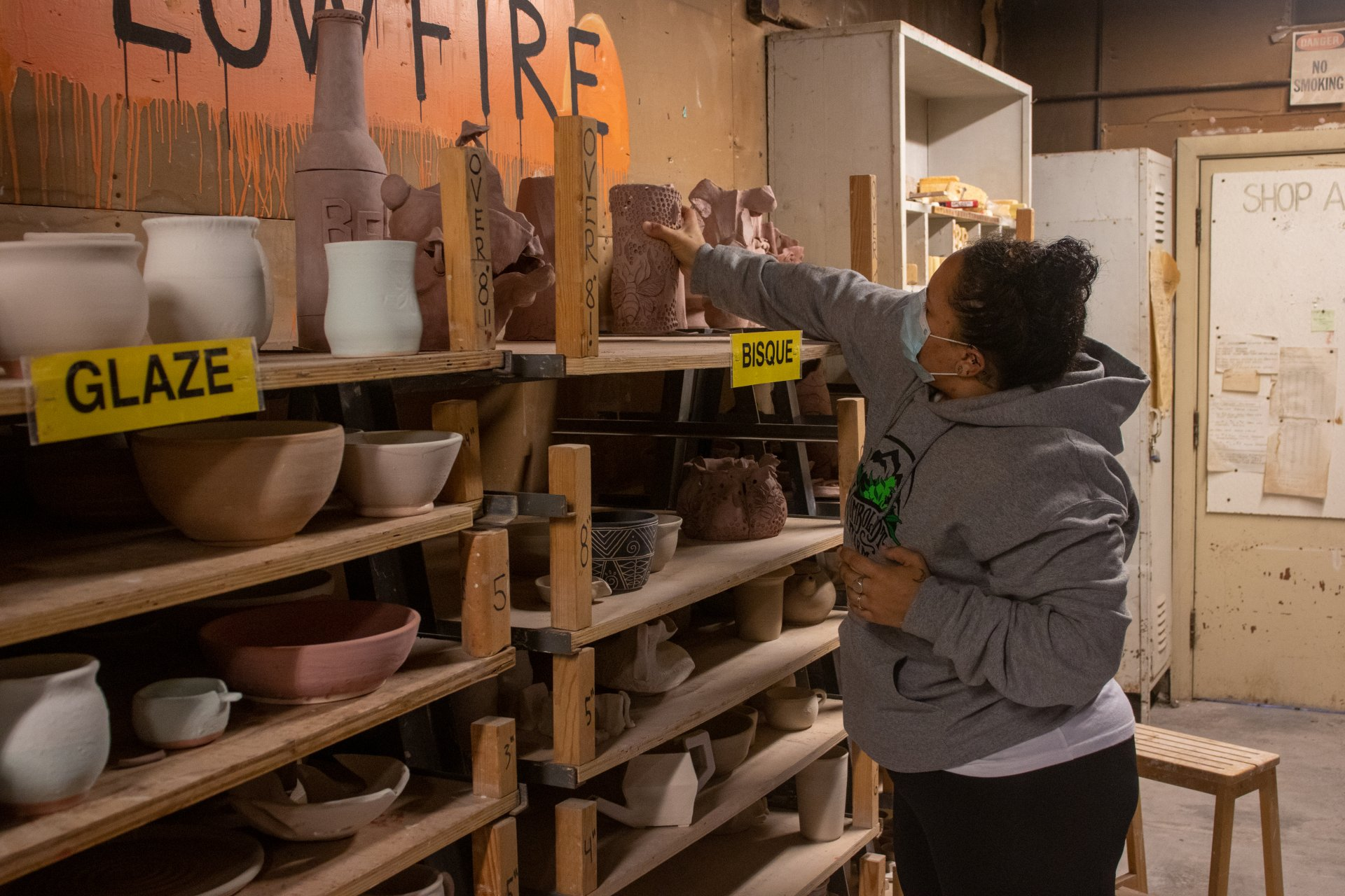 Graduate psychology major, Melissa Martin, takes ceramics as a ritual to celebrate the end of a chapter in her life, as she puts the finishing touches on her thesis. Martin drops off her project of the semester for firing on Sept. 24. | Photo by Dakota Cox.