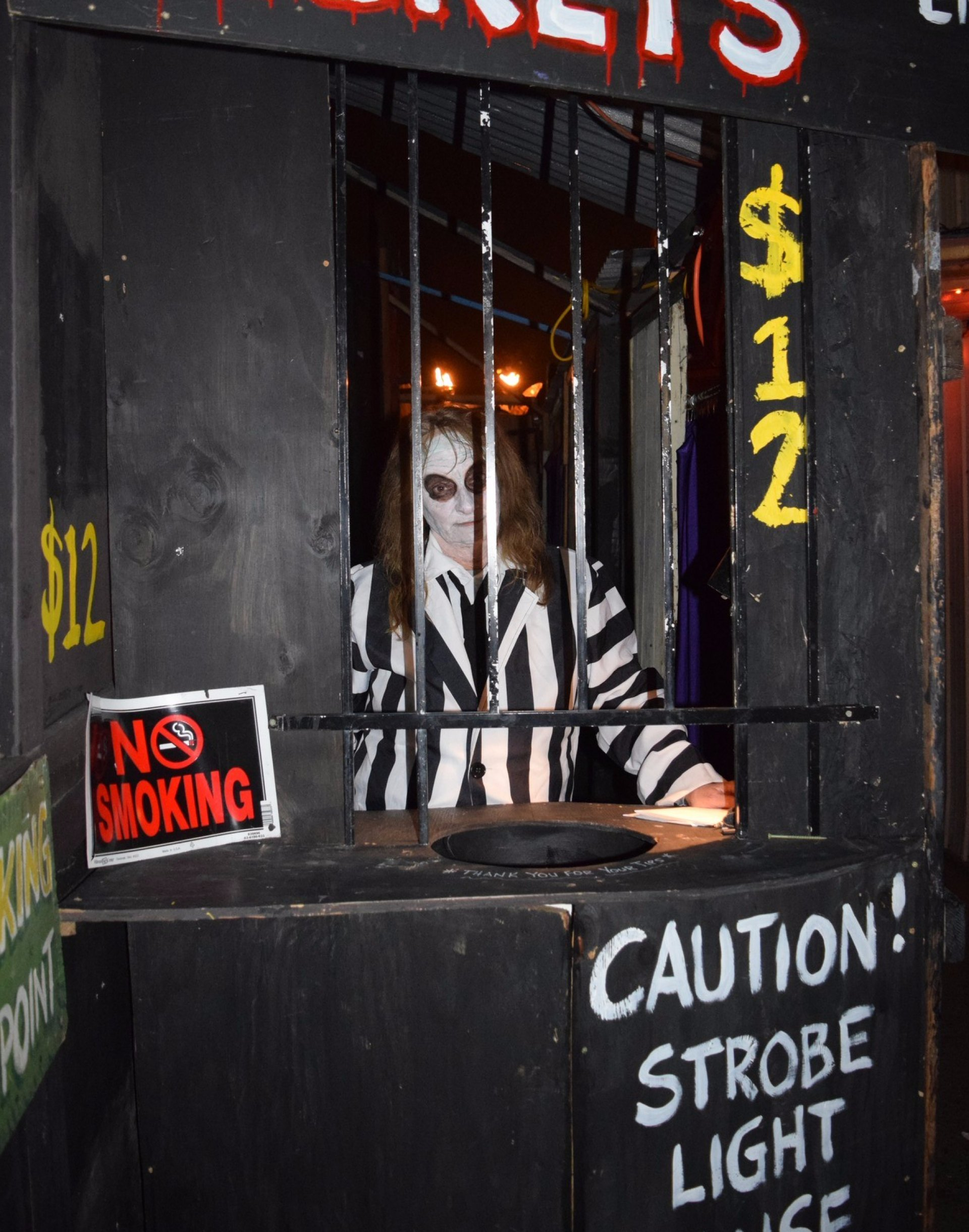 Prisoner Mary Severdia handing out tickets to peoples nightmare at the Haunted Kinetic Lab of Horrors on Oct. 28. Photo credit: Juan Herrera