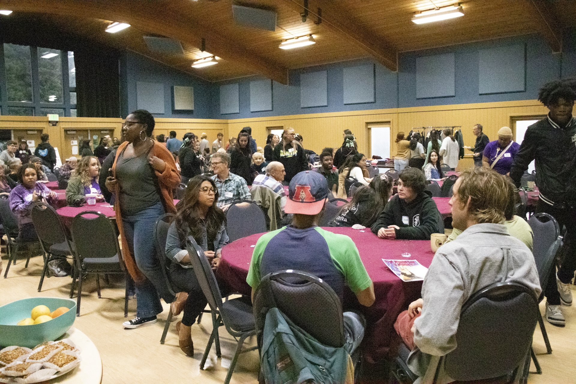 Students and community members eat, drink and break cultural boundaries at the Home Away From Home Potluck that kicked off Indigenous Peoples' Week in the fall 2019 semester. | Photo by Thomas Lal