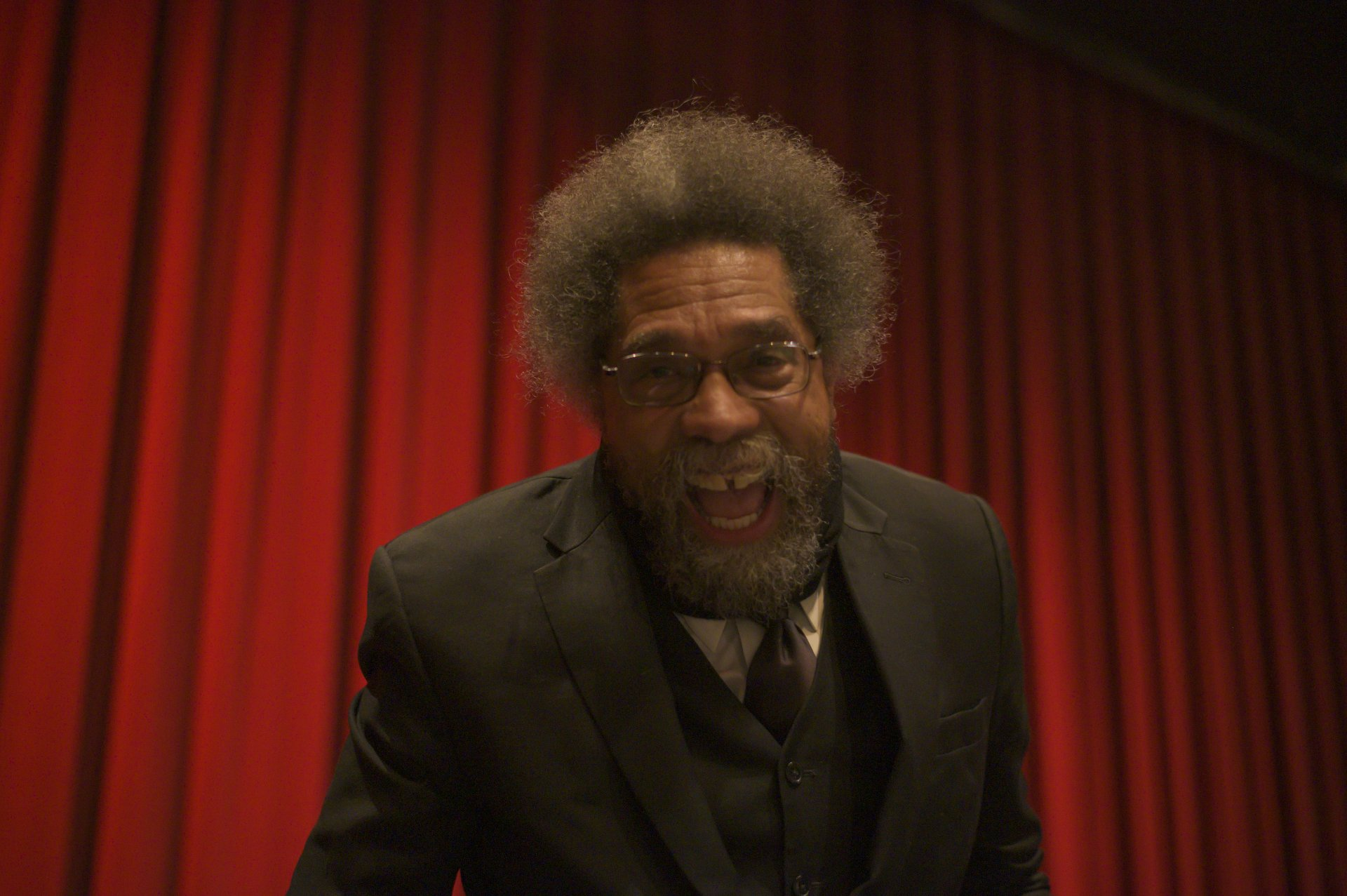 Dr. Cornel West smiles on stage after his lecture in the John Van Duzer Theatre on Feb. 7. | Photo by Benjamin Zawilski
